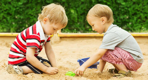 two-children-playing-in-sandbox